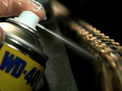 WD-40 Motorbike Chain lube being used to lubricate a motorbike chain